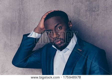 Portrait Of Successful  Handsome Afroamerican Man In Stylish Suit Touching His Hair