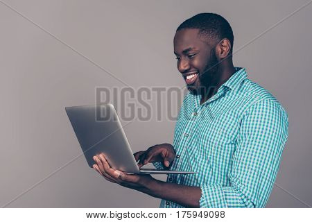 Portrait Of Happy Afroamerican Man Using Laptop Comruter And Checkin