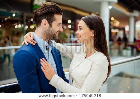 Side-view Portrait Of Happy Successful Lovely Young Family Hugs Each Other And Smiling, Walk In Mode