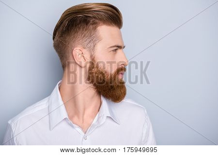 Side View Portrait Of Confident Bearded Man With Beautiful Hairstyle   In White Shirt Looking On Cop