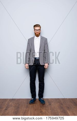 Full-length Portrait Of Serious Smart  Confident  Bearded Man In Formalwear And  Spectacles
