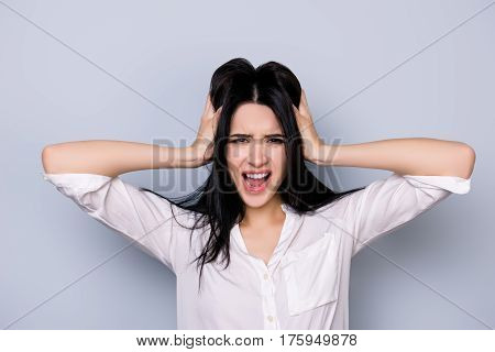 Overworked Furious Stressed Young  Woman In Rage Touching Head And Screaming With Open Mouth  In For