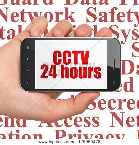 Protection concept: Hand Holding Smartphone with  red text CCTV 24 hours on display,  Tag Cloud background, 3D rendering