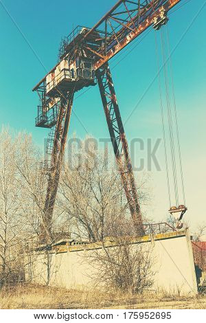 Old, Rusty Gantry Crane On Railroad, An Abandoned Concrete Plant. Crisis, Collapse Of Economy, And S