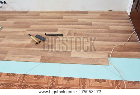 Installing and repair wooden laminate flooring with soundproof.