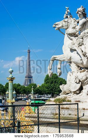 The statue of Mercury riding Pegasus in Jardin des Tuileries (Tuileries garden) with Eiffel Tower in the background. Paris France