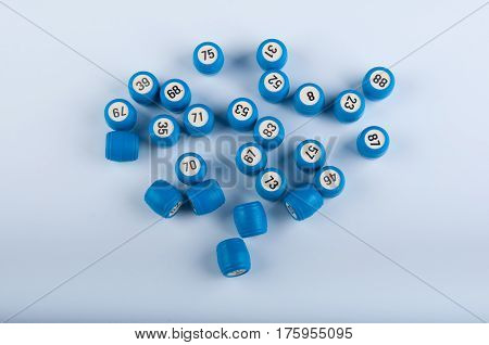 Lotto gane. Heap of blue plastic kegs on white background. Top view