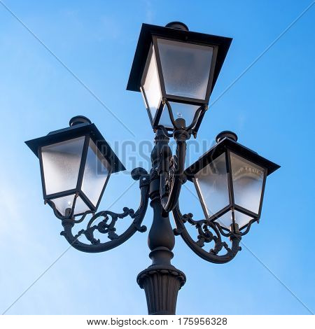 Street lamp stylized for vintage. Three plafonds close-up.