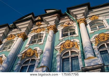 St. Petersburg. Winter Palace. View of the columns and window decor.