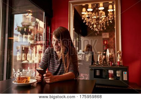 Single Young Lady Sitting In A Bar