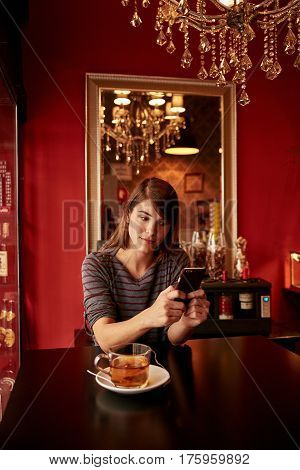 Cute Young Lady In A Pub