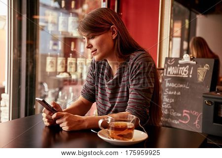 Pensive Young Lady Sitting In A Bar