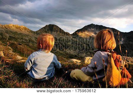 Reaching the top two children watching the mountain peak