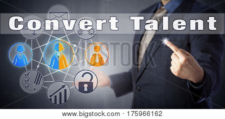 Male recruitment manager in blue business suit is advising to Convert Talent. Human resources management metaphor and recruiting strategy concept for attracting passive job seeker candidates.