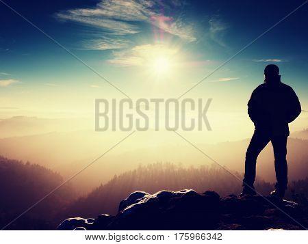 Man Silhouette On Sharp Peak. Satisfy Hiker Enjoy View