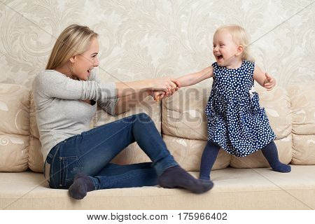 Mother and daughter are fooling around, playing and laughting together
