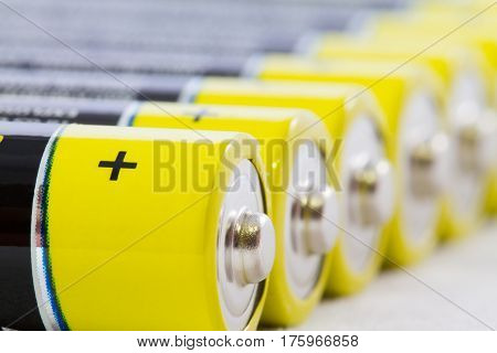 Close-up Of Yellow Black Aaa Alkaline Batteries Isolated On White