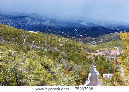 road leading towards Sandia mountains during a winter storm in the southwest, Sandia Mountains, Cedar Crest, New Mexico