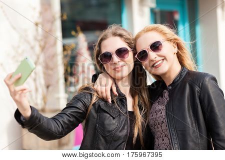 Young Female Friends Taking A Selfie Outdoor