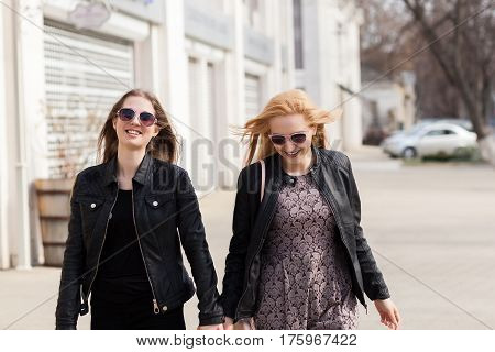 Two Girl Friends Having Fun In The City