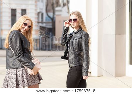 Two Gorgeous Girl Friends Having Fun Outside In The City