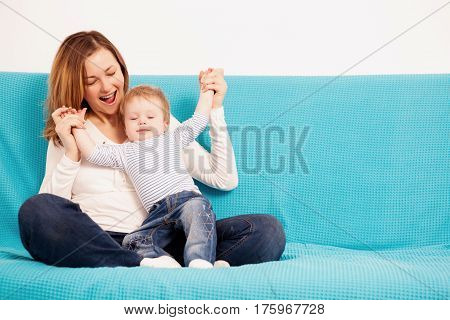 Smiling Mother And Child Son Having Fun Time Toghether
