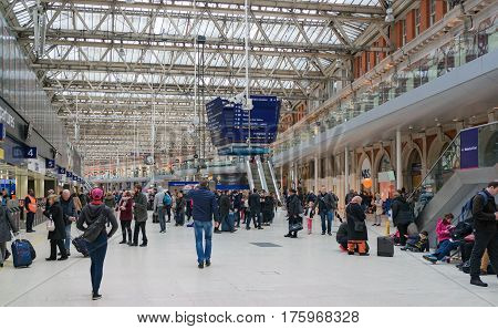 London, UK. 12th March 2017. Passengers are congregating in the main concourse at London Waterloo station awaiting their departure information on the electronic boards.