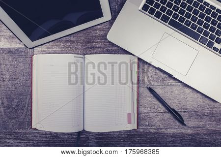 Laptop, Open Writing Notebook And Digital Tablet