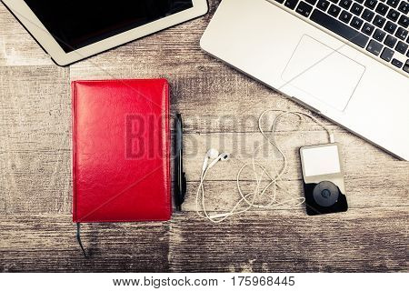 Music Player, Laptop And Writing Notebook