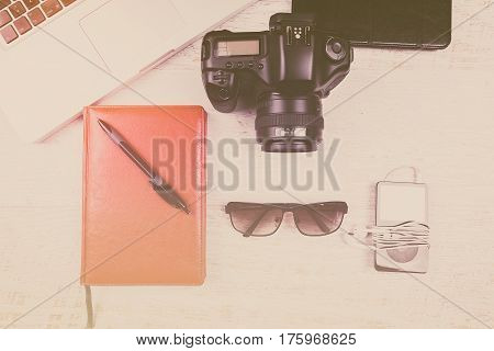 Over Top Photo Of Camera And Laptop In Vintage Tone