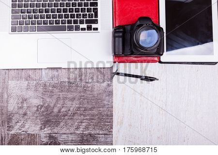 Over Top Photo Of Camera And Laptop