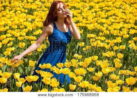 Beautiful Woman In Tulip Field