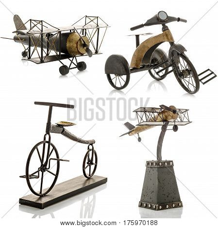 Decorative figurines, statuette of a bicycle and an airplane, accessories for an interior, isolated white background