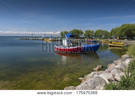 Summer view of the small harbor with wooden fishing boats