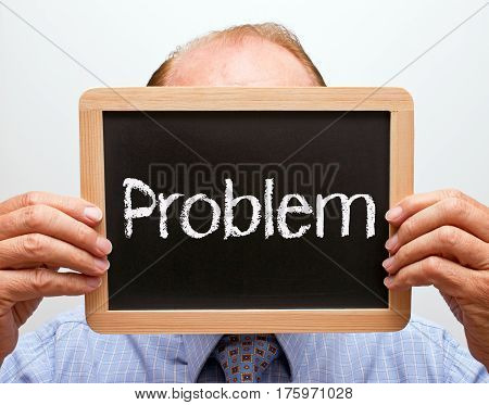 Problem - Manager holding chalkboard with text