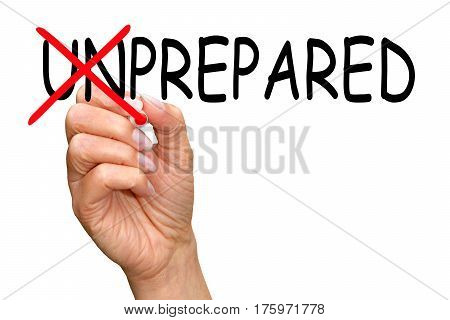 Prepared - female hand writing text on white background