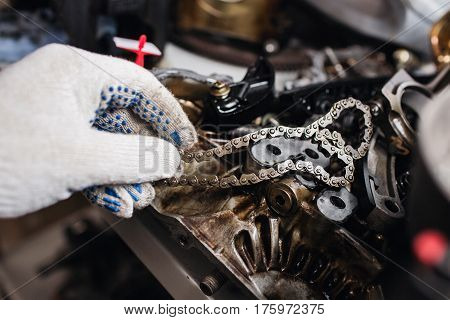 Details of car engine chain and gears, Cut away engine.