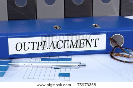 Outplacement - blue binder on desk in the office