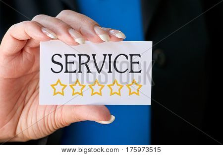Excellent Service - Five Stars - female hand with business card