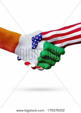 Flags Cote d'Ivoire United States countries handshake cooperation partnership and friendship or sports competition isolated on white