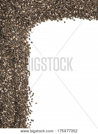 Raw unprocessed whole dried black chia seed corner edge on white background