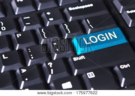 Closeup of computer keyboard with login word on the blue button