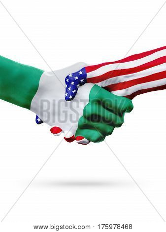Flags Nigeria and United States countries handshake cooperation partnership and friendship or sports competition isolated on white
