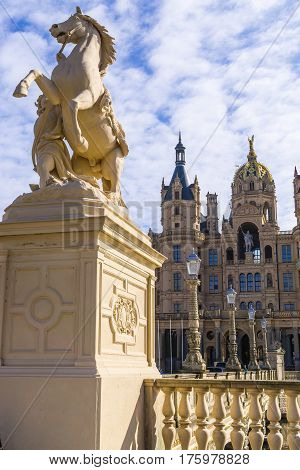 Horse statue in front of Schwerin Castle and blue sky with clouds Mecklenburg Western Pomerania Germany