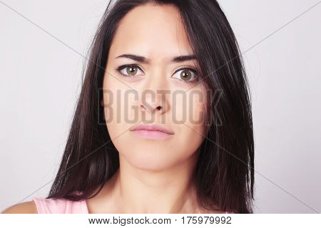 Portrait Of Young Woman With Confused Expression