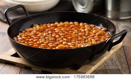 Baked white beans with tomato sauce served in a pan.