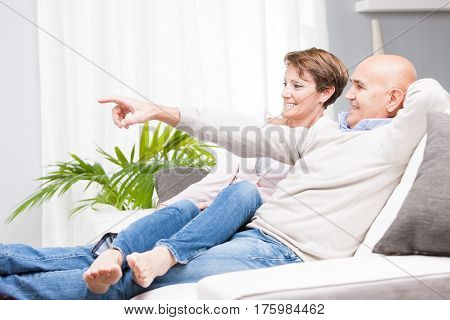 Casual Middle-aged Couple Relaxing At Home