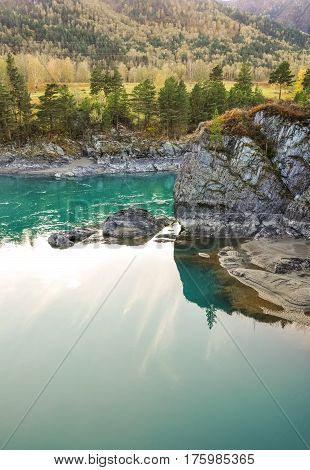 Turquoise Water Of Katun River Surrounded By Steep Cliffs. Near The Island Patmos In Altai Mountains