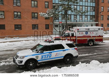 NEW YORK - FEBRUARY 9, 2017: NYPD patrol car and FDNY Ambulance in Brooklyn. FDNY is the largest combined Fire and EMS provider in the world
