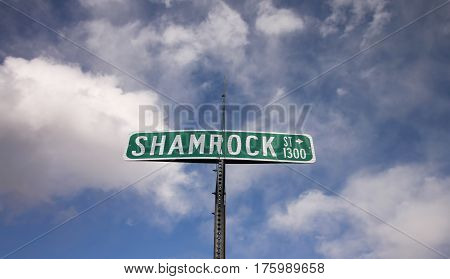 A green street sign for
